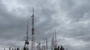 There is a large radio site with powerful transmitters near the summit.